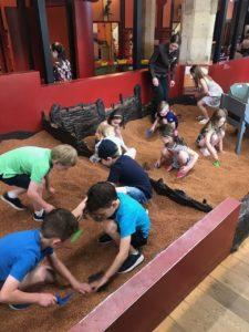 Children digging at DIG