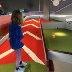 Puttstars York child playing indoor golf accessible days out in York