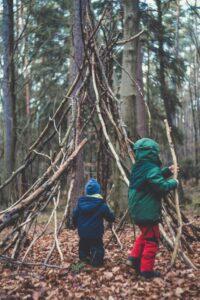 children building a den on a woodland walk in york
